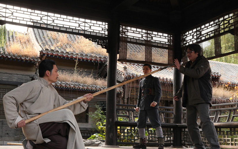 Xu Haofeng directing an actor on the set of Judge Archer